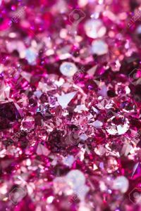 11212144-Many-small-ruby-diamond-stones-luxury-background-shallow-depth-of-field-Stock-Photo